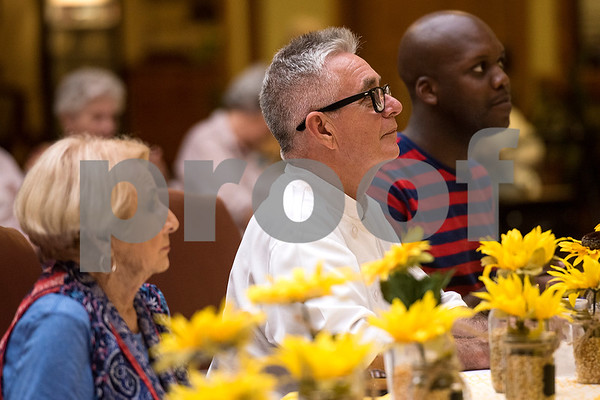David Wallace, center, sits with other judges during the chef showdown at Atria Willow Park in Tyler, Texas, on Thursday, July 20, 2017. Two teams faced off and cooked an appetizer, entree and dessert for judges, with all dishes including corn. (Chelsea Purgahn/Tyler Morning Telegraph)