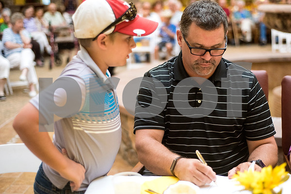 Lane Weems, 9, and Coy Weems judge a dish during the chef showdown at Atria Willow Park in Tyler, Texas, on Thursday, July 20, 2017. Two teams faced off and cooked an appetizer, entree and dessert for judges, with all dishes including corn. (Chelsea Purgahn/Tyler Morning Telegraph)