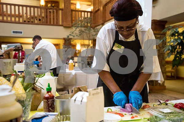 Lisa Pinson cuts vegetables during the chef showdown at Atria Willow Park in Tyler, Texas, on Thursday, July 20, 2017. Two teams faced off and cooked an appetizer, entree and dessert for judges, with all dishes including corn. (Chelsea Purgahn/Tyler Morning Telegraph)