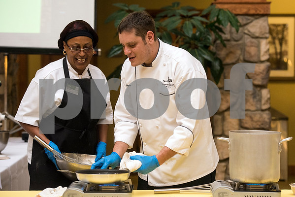 Lisa Pinson and John Novak cook during the chef showdown at Atria Willow Park in Tyler, Texas, on Thursday, July 20, 2017. Two teams faced off and cooked an appetizer, entree and dessert for judges, with all dishes including corn. (Chelsea Purgahn/Tyler Morning Telegraph)