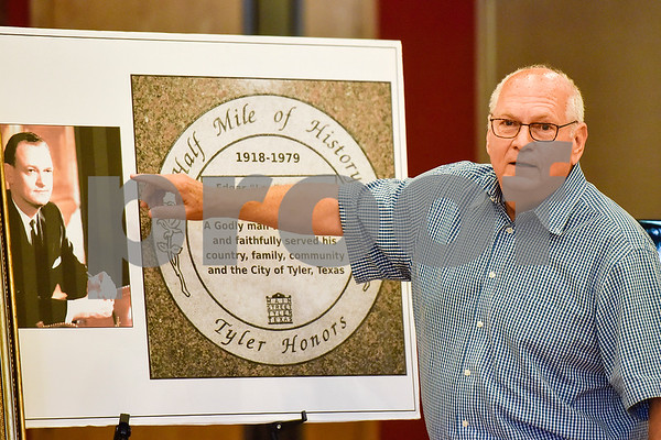 """John Chesley speaks during a Half Mile of History marker dedication ceremony honoring his father Edgar """"Leo"""" Chesley at Gallery Main Street in Tyler, Texas, on Tuesday, July 25, 2017. The Half Mile of History is a permanent, outdoor half-mile loop in downtown Tyler. The goal of the Half Mile of History program is to pay tribute to people, places, organizations and events that have contributed to the rich history of Tyler and Smith County. (Chelsea Purgahn/Tyler Morning Telegraph)"""