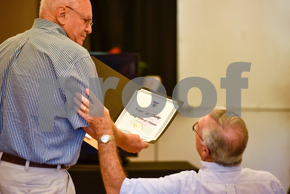 """John Chesley shows Art Johnson a certificate honoring his father during a Half Mile of History marker dedication ceremony honoring Edgar """"Leo"""" Chesley at Gallery Main Street in Tyler, Texas, on Tuesday, July 25, 2017. The Half Mile of History is a permanent, outdoor half-mile loop in downtown Tyler. The goal of the Half Mile of History program is to pay tribute to people, places, organizations and events that have contributed to the rich history of Tyler and Smith County. (Chelsea Purgahn/Tyler Morning Telegraph)"""
