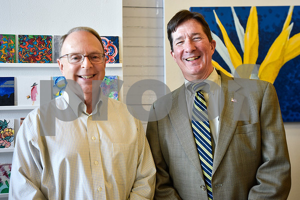Stephen Dement and Chris Leahy pose for a photo at Gallery Main Street in Tyler, Texas, on Tuesday, July 25, 2017. (Chelsea Purgahn/Tyler Morning Telegraph)
