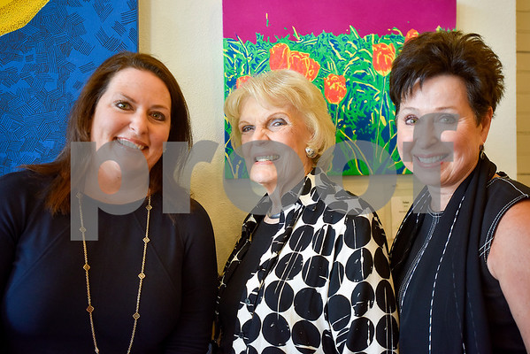 Catherine Goodgion, Cathy Powell and Pam Chesley pose for a photo at Gallery Main Street in Tyler, Texas, on Tuesday, July 25, 2017. (Chelsea Purgahn/Tyler Morning Telegraph)