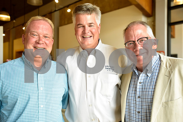 Phil Smith, Robert Owens and city councilman Don Warren pose for a photo at Gallery Main Street in Tyler, Texas, on Tuesday, July 25, 2017. (Chelsea Purgahn/Tyler Morning Telegraph)
