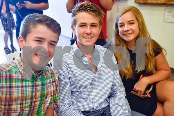 Cade Chesley, 13, Cole Turman, 15, and Claire Chesley, 17, pose for a photo at Gallery Main Street in Tyler, Texas, on Tuesday, July 25, 2017. (Chelsea Purgahn/Tyler Morning Telegraph)
