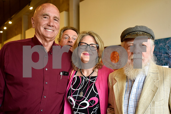 Ron Wells, Roger Chesley, Amy Proctor and Dr. Kerfoot Walker pose for a photo at Gallery Main Street in Tyler, Texas, on Tuesday, July 25, 2017. (Chelsea Purgahn/Tyler Morning Telegraph)