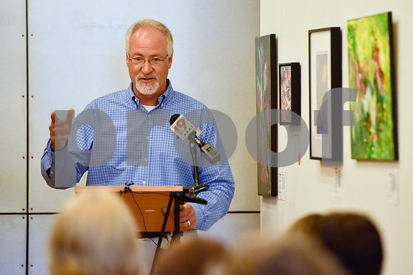 """Mayor Martin Heines speaks during a Half Mile of History marker dedication ceremony honoring Edgar """"Leo"""" Chesley at Gallery Main Street in Tyler, Texas, on Tuesday, July 25, 2017. The Half Mile of History is a permanent, outdoor half-mile loop in downtown Tyler. The goal of the Half Mile of History program is to pay tribute to people, places, organizations and events that have contributed to the rich history of Tyler and Smith County. (Chelsea Purgahn/Tyler Morning Telegraph)"""