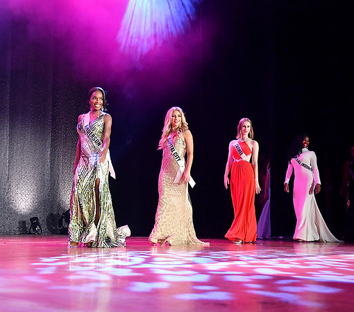 Miss Anderson, A'niyah Birdsong, left, enters the stage with other contestants in the evening gown competition at the Miss Indiana USA & Miss Indiana Teen USA pageant Monday evening at the Paramount Theatre.