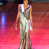 Miss Anderson, A'niyah Birdsong, models her evening gown during Monday's <br /> Miss Indiana USA competition on the Paramount Theatre stage.
