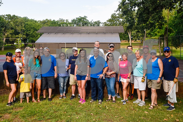 Members of South Tyler Rotary pose for a photo after a cleanup at Bergfeld Park as part of Keep Tyler Beautiful's Adopt-A-Park Program in Tyler, Texas, on Monday, July 30, 2018. (Chelsea Purgahn/Tyler Morning Telegraph)