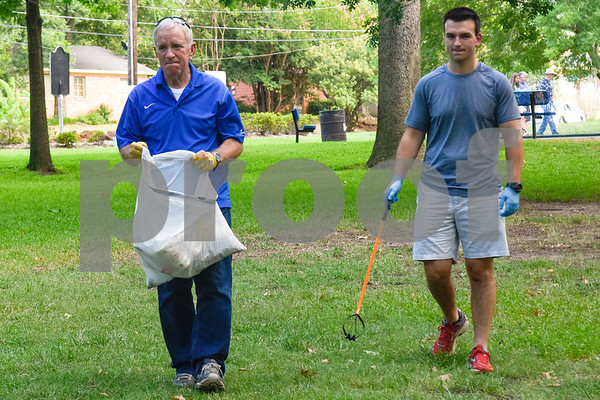 Jeff Johnston and Dalton Dickerson look for trash during a cleanup with South Tyler Rotary members at Bergfeld Park as part of Keep Tyler Beautiful's Adopt-A-Park Program in Tyler, Texas, on Monday, July 30, 2018. (Chelsea Purgahn/Tyler Morning Telegraph)