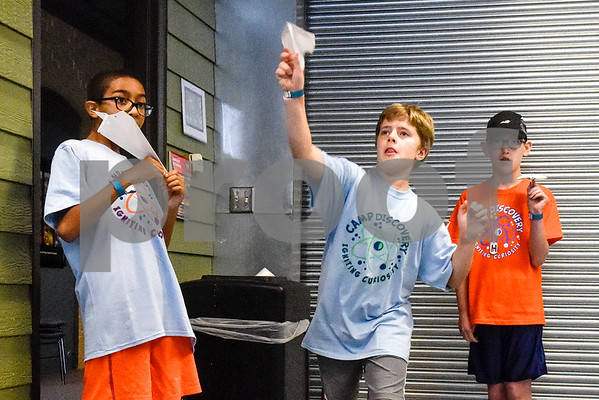 Cael Pennington, 10, Dashiell Cline, 9, and Matthew Thompson, 11, play with their paper airplanes during the Take Flight and Make it Move Camp at Discovery Science Place in Tyler, Texas, on Monday, July 30, 2018. (Chelsea Purgahn/Tyler Morning Telegraph)