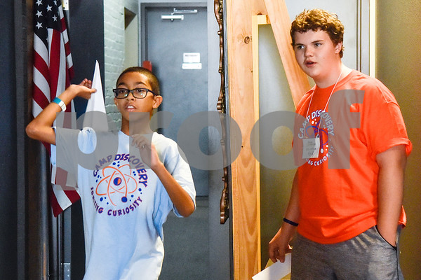 Cael Pennington, 10, throws a paper airplane as Ford Wooldridge watches during the Take Flight and Make it Move Camp at Discovery Science Place in Tyler, Texas, on Monday, July 30, 2018. (Chelsea Purgahn/Tyler Morning Telegraph)