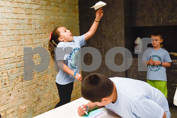 Julia Gonzalez, 7, throws a paper airplane during the Take Flight and Make it Move Camp at Discovery Science Place in Tyler, Texas, on Monday, July 30, 2018. (Chelsea Purgahn/Tyler Morning Telegraph)