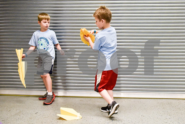 Koltyn Cochran, 6, and Kayden Cash, 6, play with paper airplanes during the Take Flight and Make it Move Camp at Discovery Science Place in Tyler, Texas, on Monday, July 30, 2018. (Chelsea Purgahn/Tyler Morning Telegraph)