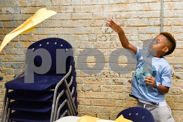 Justin Tave, 7, throws a paper airplane during the Take Flight and Make it Move Camp at Discovery Science Place in Tyler, Texas, on Monday, July 30, 2018. (Chelsea Purgahn/Tyler Morning Telegraph)