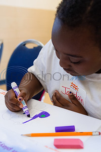 Ten-year-old Jaydah Nails colors in her dream Gassaway Park playground during a kick off event for Tyler Parks and Recreation's KaBOOM! project Tuesday at Glass Recreation Center.   (Cara Campbell/Tyler Morning Telegraph)