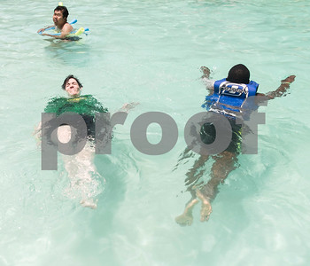 People spend time in the swimming pool Thursday July 6, 2917 during Camp Kennedy at the Stone Fort Camp in Whitehouse. Camp Kennedy is a week long summer camp for adults with special needs.  (Sarah A. Miller/Tyler Morning Telegraph)