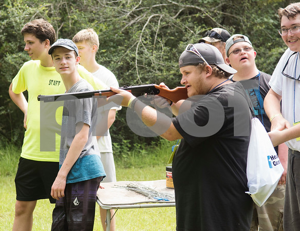 Corey Smitherman shoots a BB gun Thursday July 6, 2917 during Camp Kennedy at the Stone Fort Camp in Whitehouse. Camp Kennedy is a week long summer camp for adults with special needs.  (Sarah A. Miller/Tyler Morning Telegraph)