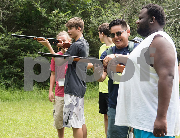 Camp counselor Jaime Calderon, center, helps camper  Leon Bluitt shoot a BB gun Thursday July 6, 2917 during Camp Kennedy at the Stone Fort Camp in Whitehouse. Camp Kennedy is a week long summer camp for adults with special needs.  (Sarah A. Miller/Tyler Morning Telegraph)