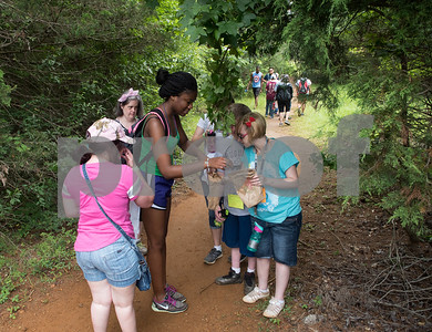 Camp counselor Jasmine Milligan leads her campers on a scavenger hunt Thursday July 6, 2917 during Camp Kennedy at the Stone Fort Camp in Whitehouse. Camp Kennedy is a week long summer camp for adults with special needs.  (Sarah A. Miller/Tyler Morning Telegraph)