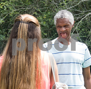Camper Johnny Washington tells counselor Catherine Lard about his upcoming birthday Thursday July 6, 2917 during Camp Kennedy at the Stone Fort Camp in Whitehouse. Camp Kennedy is a week long summer camp for adults with special needs.  (Sarah A. Miller/Tyler Morning Telegraph)