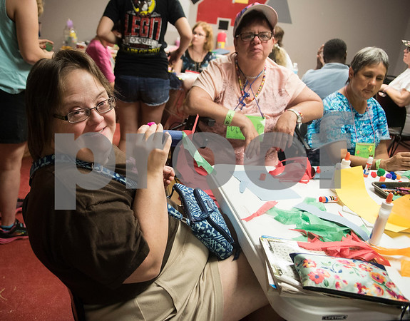 Camper Katy Gourley does arts and crafts Thursday July 6, 2917 during Camp Kennedy at the Stone Fort Camp in Whitehouse. Camp Kennedy is a week long summer camp for adults with special needs.  (Sarah A. Miller/Tyler Morning Telegraph)