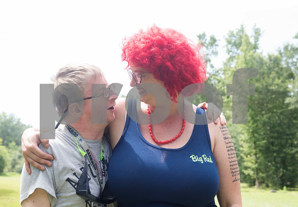Camper Alex Carpenter talks with camp director Jessica Ogden Thursday July 6, 2917 during Camp Kennedy at the Stone Fort Camp in Whitehouse. Camp Kennedy is a week long summer camp for adults with special needs.  (Sarah A. Miller/Tyler Morning Telegraph)
