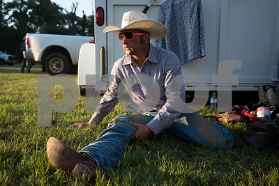 Jared Sboboda stretches during the Mineola Volunteer Fire Department Rodeo at the Fire Department Rodeo Arena in Mineola, Texas, on Friday, July 7, 2017. The rodeo featured a number of rodeo events from barrel racing to steer wrestling. (Chelsea Purgahn/Tyler Morning Telegraph)