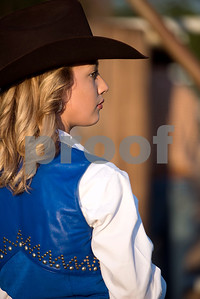 Haleigh Mitchell looks toward the arena during the Mineola Volunteer Fire Department Rodeo at the Fire Department Rodeo Arena in Mineola, Texas, on Friday, July 7, 2017. The rodeo featured a number of rodeo events from barrel racing to steer wrestling. (Chelsea Purgahn/Tyler Morning Telegraph)