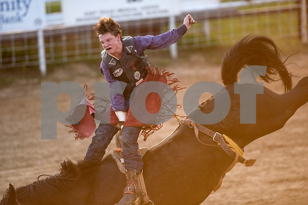 A person competes during the bareback bronc riding competition during the Mineola Volunteer Fire Department Rodeo at the Fire Department Rodeo Arena in Mineola, Texas, on Friday, July 7, 2017. The rodeo featured a number of rodeo events from barrel racing to steer wrestling. (Chelsea Purgahn/Tyler Morning Telegraph)