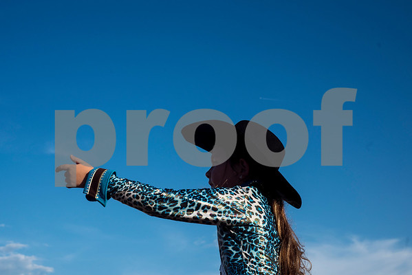 Ronica Norwood, 7, points toward the arena during the Mineola Volunteer Fire Department Rodeo at the Fire Department Rodeo Arena in Mineola, Texas, on Friday, July 7, 2017. The rodeo featured a number of rodeo events from barrel racing to steer wrestling. (Chelsea Purgahn/Tyler Morning Telegraph)