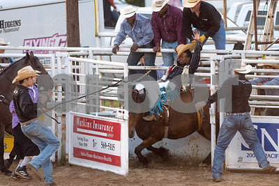 People pull open the gate at the beginning of a Kedarrius Flanagan's ride during the bareback bronc riding competition during the Mineola Volunteer Fire Department Rodeo at the Fire Department Rodeo Arena in Mineola, Texas, on Friday, July 7, 2017. The rodeo featured a number of rodeo events from barrel racing to steer wrestling. (Chelsea Purgahn/Tyler Morning Telegraph)
