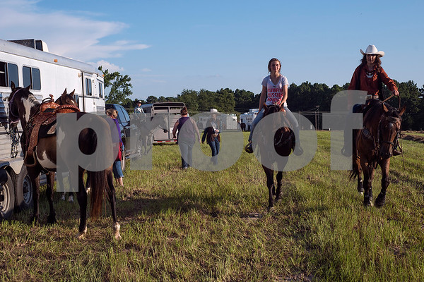 People get ready for the Mineola Volunteer Fire Department Rodeo at the Fire Department Rodeo Arena in Mineola, Texas, on Friday, July 7, 2017. The rodeo featured a number of rodeo events from barrel racing to steer wrestling. (Chelsea Purgahn/Tyler Morning Telegraph)