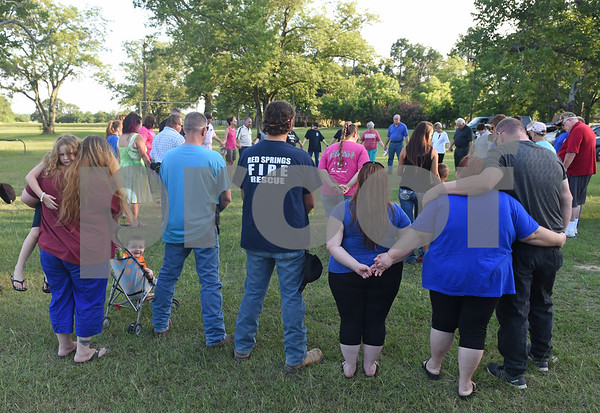 Over 40 people attend a prayer gathering lead by Chad McElyea, a Lindale Police Department detective, at Pool Park in Lindale Friday. The event was in response to the police officers killed Thursday night in downtown Dallas by a sniper.  (Sarah A. Miller/Tyler Morning Telegraph)