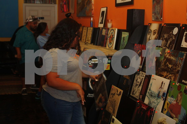 Visitors shop for vintage records at El Guapo Records during Hit The Bricks Art Fair.