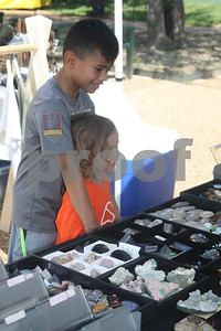 Vistors shop for trinkets and other baragins at Hit The Bricks Art Fair, Downtown Tyler,