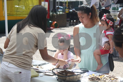 Vistors shop for trinkets and other bargins at Hit The Bricks Art Fair, Downtown Tyler,