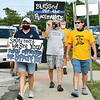 Members of the local FOP and community supporters marched around the Anderson City Building Thursday, some carrying signs, during a rally to show community support for all police officers.