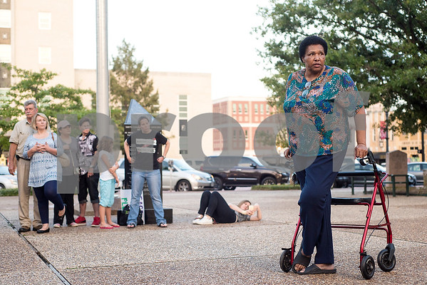 "Beverly Jackson speaks during the Inspiring Peace Rally at T.B. Butler Fountain Plaza in Tyler, Texas, on Thursday, Aug. 17, 2017. ""Our differences are what make America beautiful. It's like grandma's quilt -- all the different squares are working together."" Around 75 people attended the rally to discuss ways the community could unify. The rally was held partially in response to the attack in Charlottesville on Aug. 12, where one person was killed and 19 more injured after a car struck a group of counter-protesters demonstrating against a white nationalist rally. (Chelsea Purgahn/Tyler Morning Telegraph)"