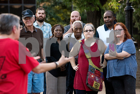 People listen to Brenda McWilliams speak during the Inspiring Peace Rally at T.B. Butler Fountain Plaza in Tyler, Texas, on Thursday, Aug. 17, 2017. Around 75 people attended the rally to discuss ways the community could unify. The rally was held partially in response to the attack in Charlottesville on Aug. 12, where one person was killed and 19 more injured after a car struck a group of counter-protesters demonstrating against a white nationalist rally. (Chelsea Purgahn/Tyler Morning Telegraph)