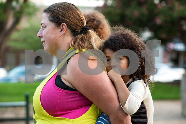 Alisa Simmons holds Kame Simmons, 4, as they listen during the Inspiring Peace Rally at T.B. Butler Fountain Plaza in Tyler, Texas, on Thursday, Aug. 17, 2017. Around 75 people attended the rally to discuss ways the community could unify. The rally was held partially in response to the attack in Charlottesville on Aug. 12, where one person was killed and 19 more injured after a car struck a group of counter-protesters demonstrating against a white nationalist rally. (Chelsea Purgahn/Tyler Morning Telegraph)