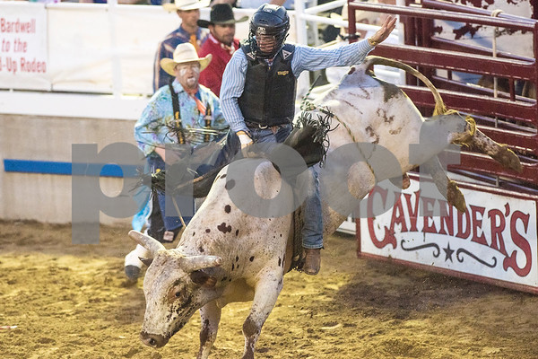 A man competes in the bull riding competition at the 81st Gladewater Round-Up Rodeo in Gladewater, Texas, on Wednesday, June 6, 2018. The rodeo events of the evening were mutton bustin', calf scrambles and bull riding. (Chelsea Purgahn/Tyler Morning Telegraph)