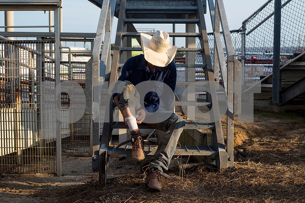 Ben Jones adjusts his sock as he gets ready for bull riding at the 81st Gladewater Round-Up Rodeo in Gladewater, Texas, on Wednesday, June 6, 2018. The rodeo events of the evening were mutton bustin', calf scrambles and bull riding. (Chelsea Purgahn/Tyler Morning Telegraph)