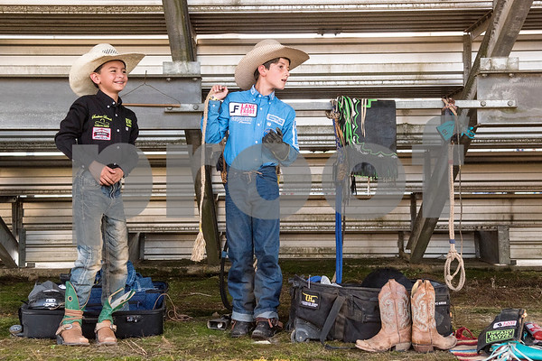 Preston Rodriguez, 9, and Ryder Carpenetti, 11, get ready for bull riding at the 81st Gladewater Round-Up Rodeo in Gladewater, Texas, on Wednesday, June 6, 2018. The rodeo events of the evening were mutton bustin', calf scrambles and bull riding. (Chelsea Purgahn/Tyler Morning Telegraph)