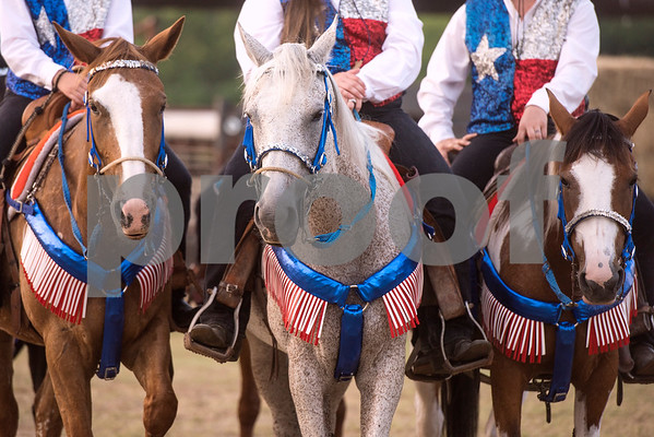Horses and riders dressed in their Texas best at the 81st Gladewater Round-Up Rodeo in Gladewater, Texas, on Wednesday, June 6, 2018. The rodeo events of the evening were mutton bustin', calf scrambles and bull riding. (Chelsea Purgahn/Tyler Morning Telegraph)