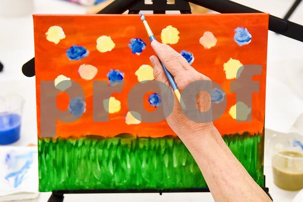 Suzan Burgett paints during a painting party at the Tyler Senior Center in Tyler, Texas, on Thursday, Aug. 23, 2018. (Chelsea Purgahn/Tyler Morning Telegraph)