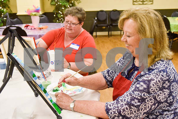 Maresa Campbell and Diana Perry paint during a painting party at the Tyler Senior Center in Tyler, Texas, on Thursday, Aug. 23, 2018. (Chelsea Purgahn/Tyler Morning Telegraph)