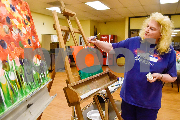 JoAnn Taylor leads the group in instruction during a painting party at the Tyler Senior Center in Tyler, Texas, on Thursday, Aug. 23, 2018. (Chelsea Purgahn/Tyler Morning Telegraph)